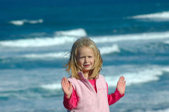 Girl gesturing stop by sea Stock Photo