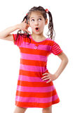 Girl gesturing talking on telephone Royalty Free Stock Image