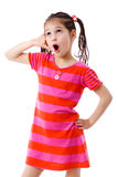 Girl gesturing talking on telephone Stock Images