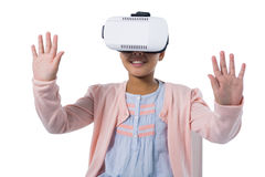Girl gesturing while using virtual reality headset Stock Photo