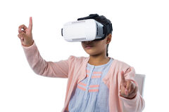 Girl gesturing while using virtual reality headset Stock Images