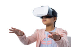 Girl gesturing while using virtual reality headset Stock Photos