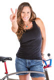 Girl Gesturing Victory with Her Bike Royalty Free Stock Photo