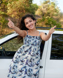 Girl gesturing on white car background Stock Photography
