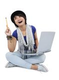 A girl get an idea with a laptop. On white background Royalty Free Stock Photo