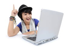 A girl get an idea with laptop. On white background Royalty Free Stock Image