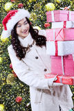 Girl get surprise christmas gift Royalty Free Stock Photography