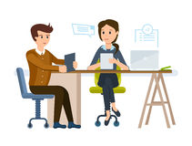 Girl gets acquainted with young man`s resume, conducts an interview. Royalty Free Stock Images