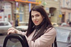 Girl gets into the car Royalty Free Stock Photos