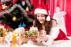 Girl gets a Christmas present Stock Photos