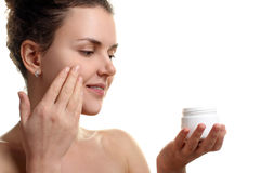 Girl gets a face cream Royalty Free Stock Images