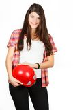 A girl gets on the hip a red building helmet Royalty Free Stock Photos