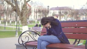 Girl gets a sad message and cries stock footage