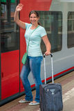 Girl gets on the train Royalty Free Stock Images