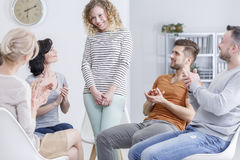 Girl getting applause. During support group meeting Royalty Free Stock Photos