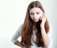 Girl getting bad news Royalty Free Stock Image