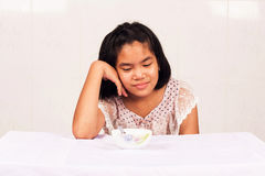 girl getting bored with food Stock Images