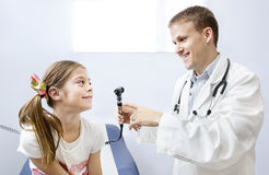 Girl getting a checkup at the Doctor's office Stock Photo