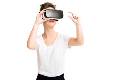 Girl getting experience using VR glasses of virtual reality Stock Image