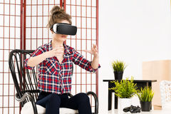 Girl getting experience using VR glasses of virtual reality Stock Photo