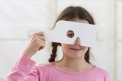 Girl getting eye exam Stock Images