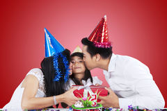 Girl getting a gift and kiss royalty free stock images