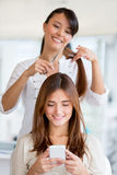 Girl getting a haircut Stock Image