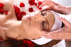 Girl getting head massage Stock Photos