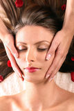 Girl getting head massage Royalty Free Stock Images