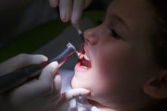 Girl getting her teeth polished Stock Photo