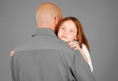 Girl getting hug from father Stock Photography
