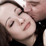 Girl is getting a kiss Royalty Free Stock Photos