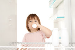 Girl getting milk Royalty Free Stock Images