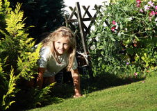 Girl getting out from bush Royalty Free Stock Photo