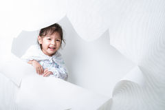 Girl Getting Out From a Hole on White Background #2. Cute girl from the white hole Royalty Free Stock Images