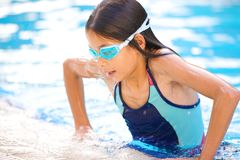 Girl getting out of pool Stock Image