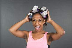 Girl getting ready with curlers in her hair Stock Photos