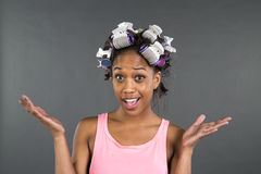 Girl getting ready with curlers in her hair Royalty Free Stock Photography