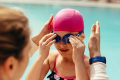 Girl getting ready for her swimming class stock images
