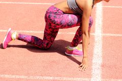 girl getting ready to start running. stock photography