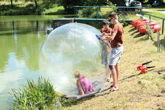 Girl getting ready for water-zorbing Stock Photo