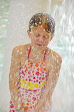 Girl getting splashed Stock Photo
