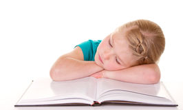 A girl getting tired of reading Stock Image