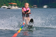 Girl Getting Up on Slalom Ski royalty free stock photo