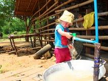 Girl Getting Water Stock Image