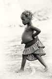 A girl from Ghana walks away Stock Image