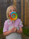 Girl With Giant Lollipop Stock Photo