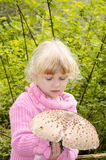 Girl with giant mushroom Royalty Free Stock Photo