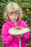 Girl with giant parasol mushroom Royalty Free Stock Image