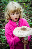 Girl with giant parasol mushroom Stock Photography